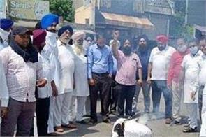 protest against sadhu singh dharamsot