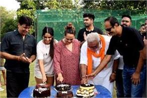 13 years of yuvraj  6 sixes  his wife and father cut the cake