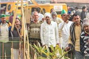 rakesh tikait water saplings planted by farmers at ghazipur border