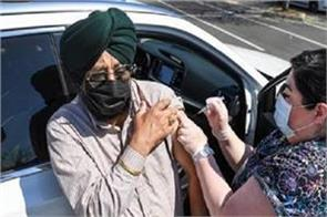 usa  corona vaccine administered to punjabi food and agricultural workers