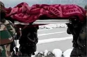 army personnel help a pregnant woman reach hospital