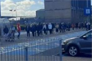 scotland  lockdown restrictions eased  long queues in front of stores in glasgow