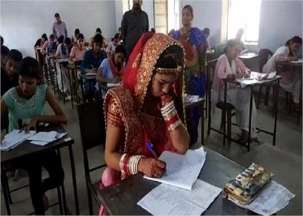 bride takes exam in wedding