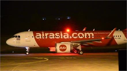 emergency landing at airasia at kolkata airport after threatening call