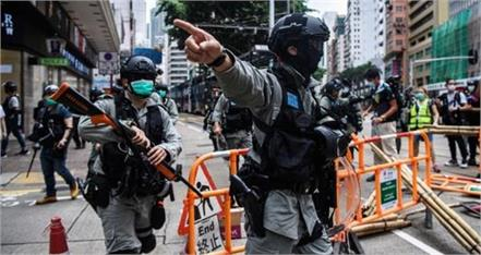 china calls protests   terrorism   on hong kong