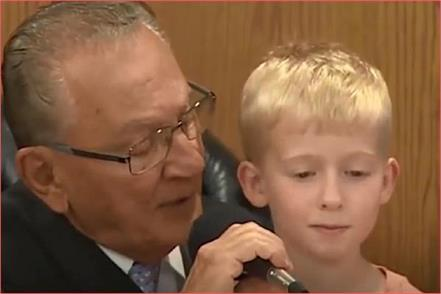 a 5 year old boy sitting on the judge  s lap sentenced his own father