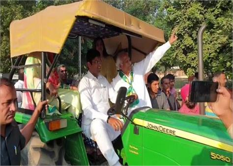 haryana assembly polls dushyant chautala vote on a tractor