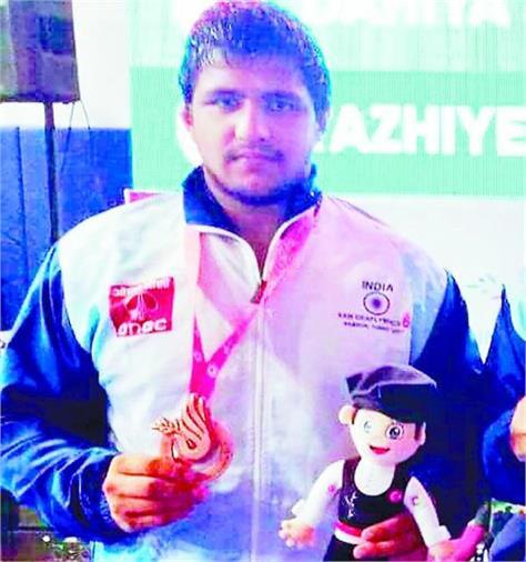 story of a wrestler who won a bronze for the country at the world deaf olympics