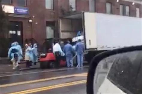 corona  video of bodies dumped in new york hospital  in public